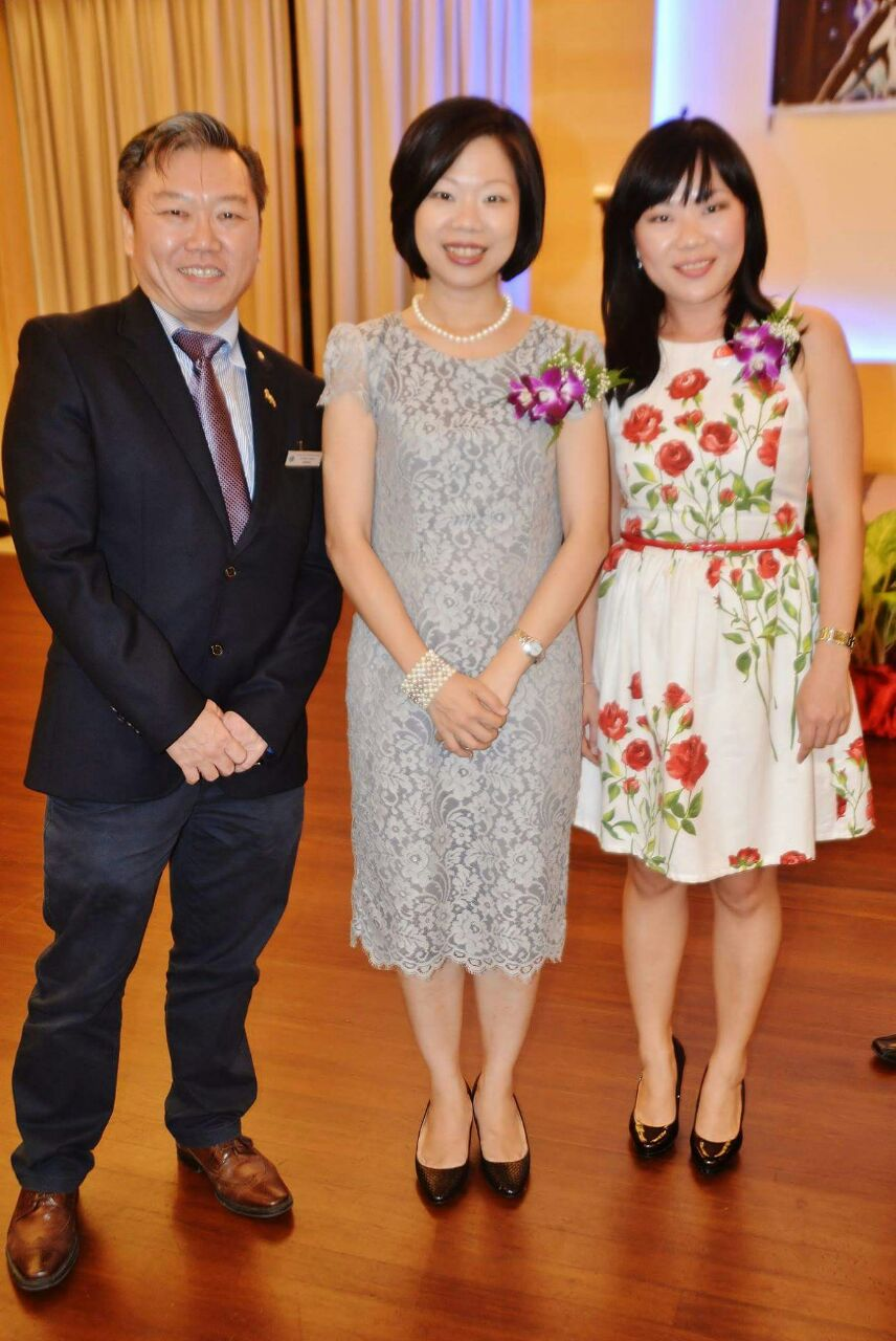 Jeffrey Tan lions club charter with Ms Sim Ann